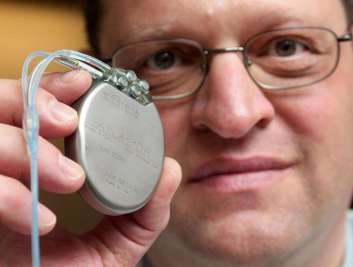 Dr. Bruce Wilkoff of the Cleveland Clinic holds a heart defibrillator implant, one of the medical devices affected by an excise tax under the Affordable Care Act.