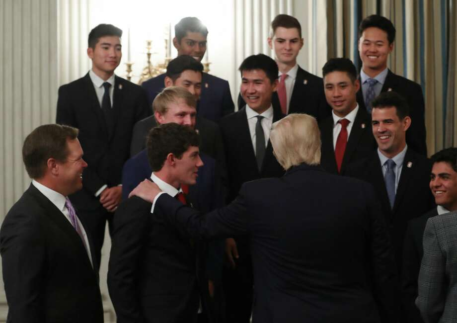 President Donald Trump talks with members of the Stanford University Golf team in the State Dining Room during the NCAAÂ Collegiate National Champions Day at the White House on November 22, 2019 in Washington, DC. The White House recognized champion collegiate student athletes from sports ranging from wrestling to hockey during their annual NCAA Collegiate National Champions Day. Photo: Mark Wilson/Getty Images