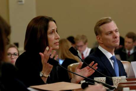 Dr. Fiona Hill, left, the former top Russia and Europe expert on the National Security Council, while joined by David Holmes, an official from the U.S. embassy in Ukraine, testifies during the open hearing of the House Intelligence Committee into the impeachment inquiry of President Donald Trump on Thursday, Nov. 21, 2019, in Washington, D.C. (Kirk McKoy/Los Angeles Times/TNS)