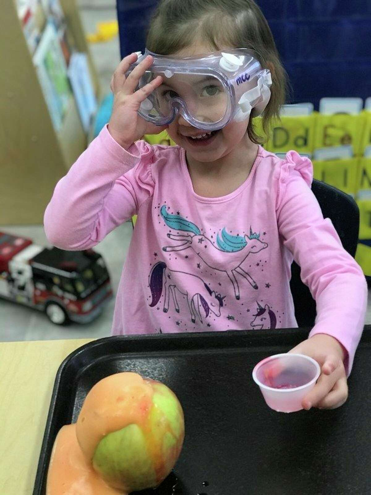 Look what I created seems to be what this smiling young Manistee Catholic Central student is saying about her apple volcano.