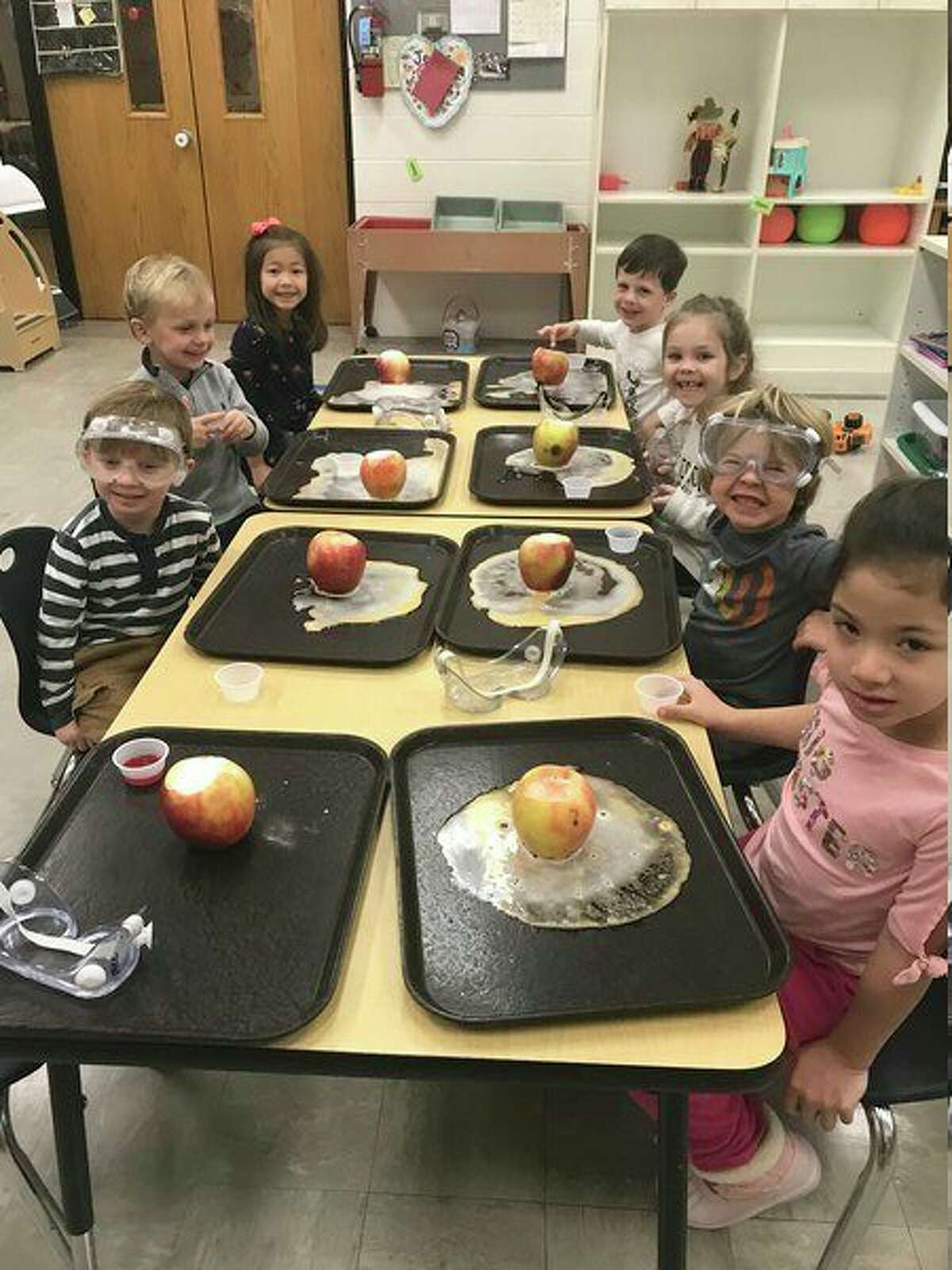 Students were all smiles as they proudly show off their apple volcanoes.