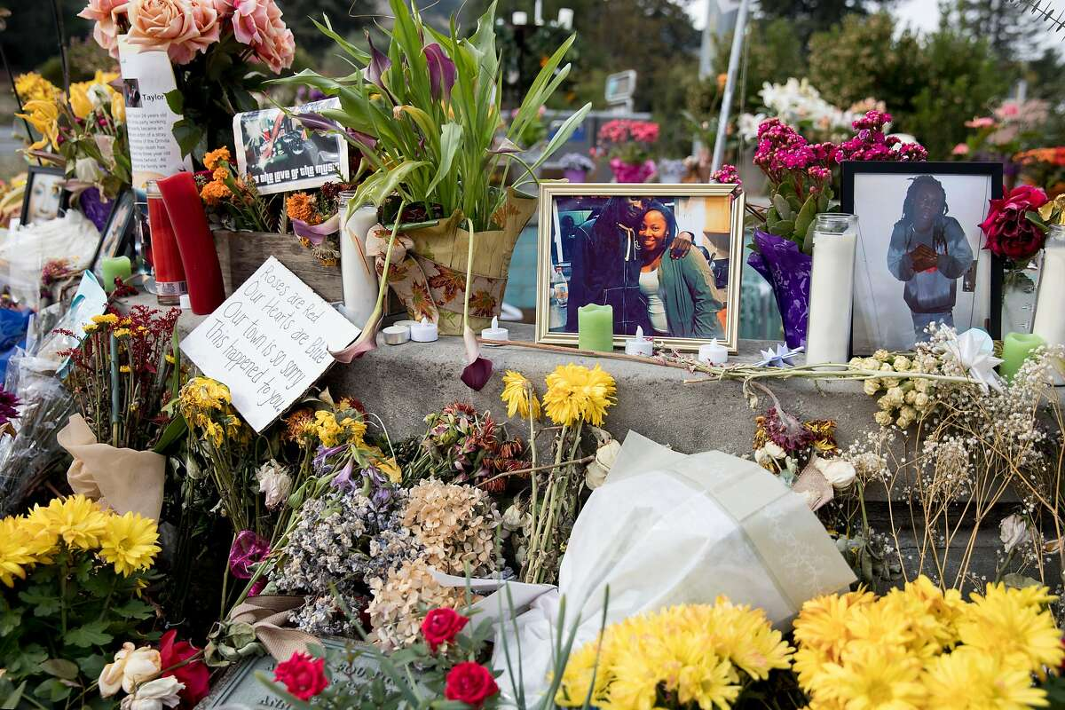 A makeshift memorial is seen in downtown Orinda, Calif. Wednesday, Nov. 13, 2019 after five were killed during a Halloween house party.