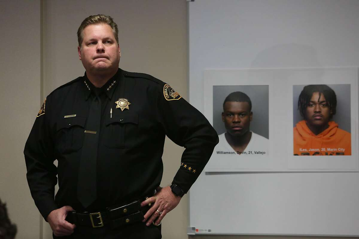 Contra Costa County Sheriff David Livingston stands next to booking mugs during a press conference about the Orinda shooting at the Contra Costa County Office of the Sheriff, Field Operations Building,on Friday, November 15, 2019 in Martinez, Calif.