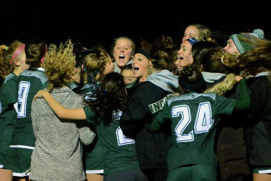 Guilford celebrates its win over Shelton in the SCC championship on Nov. 6. Photo: Christian Abraham / Hearst Connecticut Media / Connecticut Post