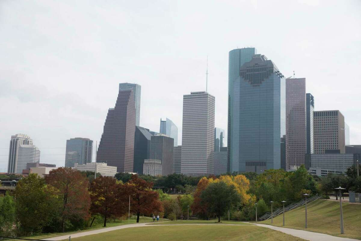Colorful trees along the Buffalo Bayou trails are photographed against the Houston skyline on Friday, Nov. 22, 2019, in Houston.