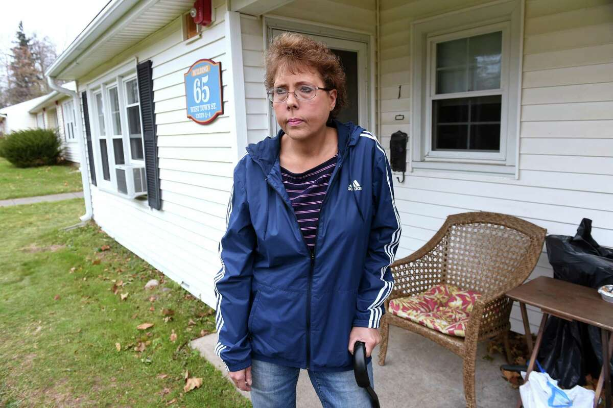 Lori Wierzbicki is photographed outside of her home at the Milford Housing Authority's apartments on Jepson Drive in Milford on November 18, 2019 where she was assaulted in March of 2019.