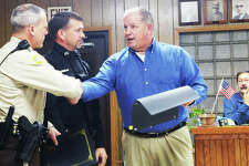 Grafton Mayor Rick Eberlin, right, presents certificates of appreciation to Jersey County Deputy Justin Decker, left, and Grafton Police Officer Mike Angel during the village's Nov 19 council meeting. The two officers were honored for their outstanding performance during a Grafton fire where they quickly evacuated residents and minimized property loss.