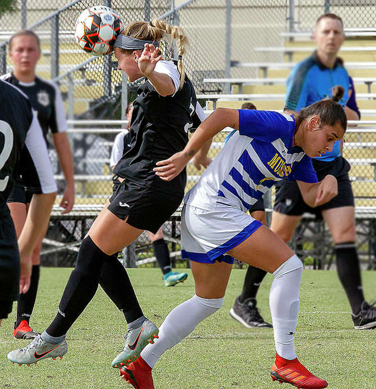 LCCC's Sydney Schmidt, left, heads the ball away as Monroe's Luana Grabias heads the opposite direction Friday in the semifinals of the NJCAA National Tournament.