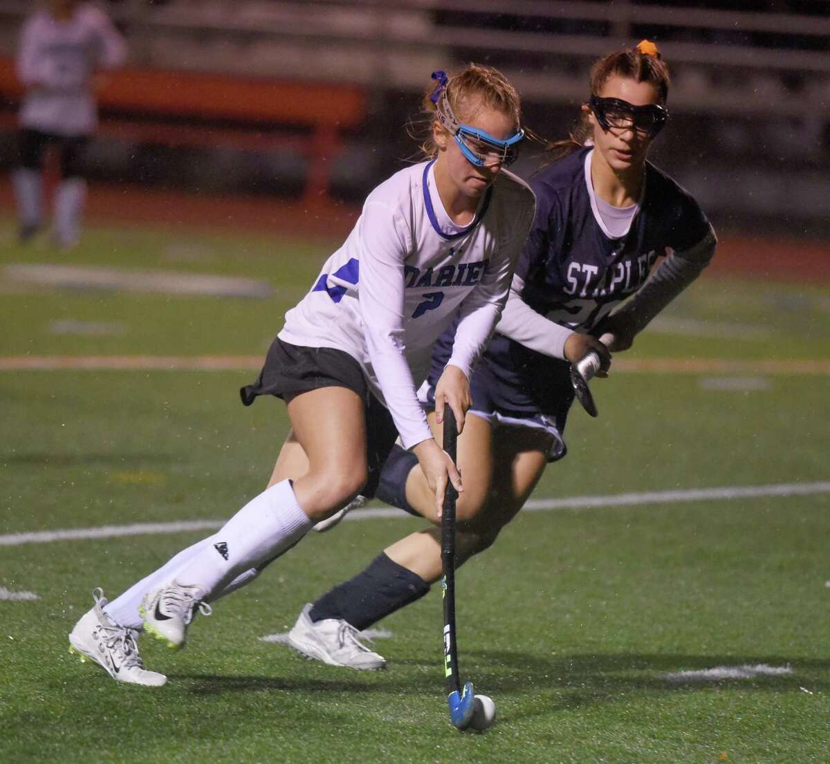 Darien's Molly Hellman controls the ball as Staples' Jessica Leon defends during the FCIAC final on Nov. 7.