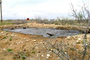 The site included an associated pit, which contained hydrocarbons, and had to be cleaned up.