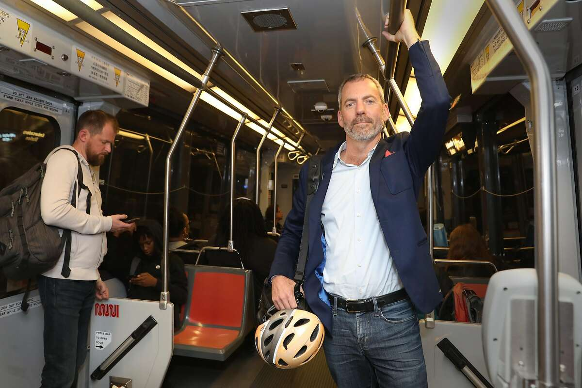 New Muni director Jeffrey Tumlin seen on Muni bus stopping at the Powell St. Station on Market St.on Wednesday, Nov. 20, 2019, in San Francisco, Calif..