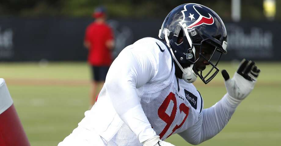Houston Texans defensive end Joel Heath (93) breaks to the ball after hitting a blocking sled during training camp at the Methodist Training Center on Aug. 10, 2019, in Houston. Photo: Brett Coomer/Staff Photographer