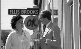 Marie Brooks in front of Ellis Brooks Chevrolet on Van Ness, April 11, 1988