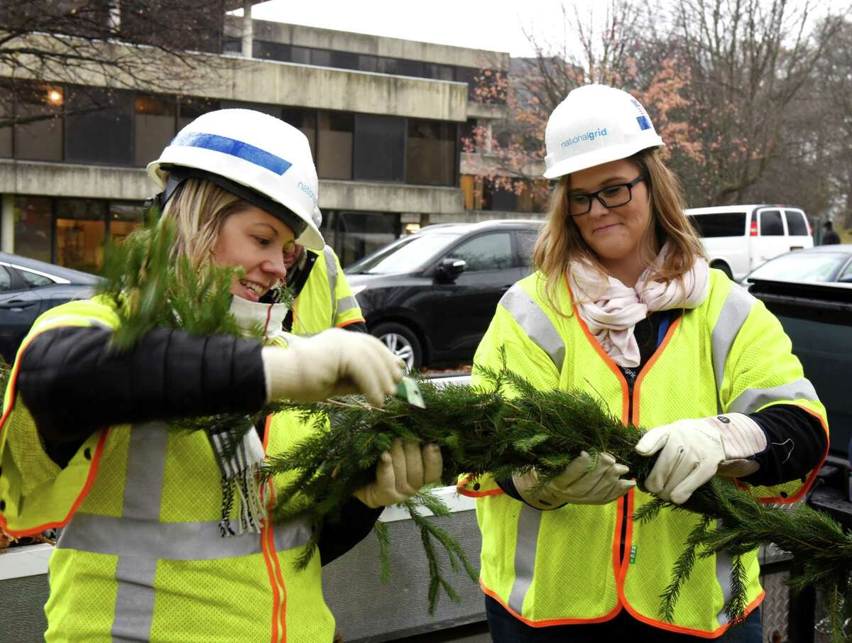 National Grid employees; Rachel McCrea, left, and Sarah Tompkins, right, help to decorate the Albany Ronald McDonald House for the holidays on Friday, Nov. 22, 2019, in Albany, N.Y. The company has donated its employeesA?• time and equipment to this event for the past several years. (Will Waldron/Times Union)
