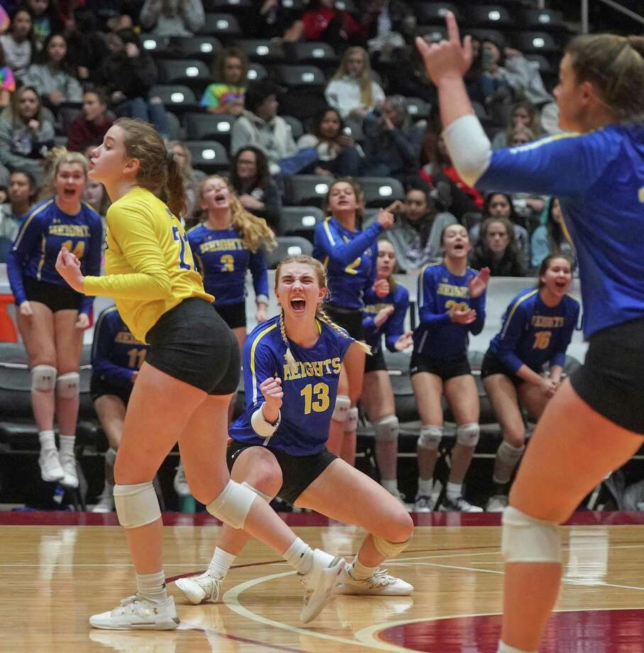 Alimo Heights' Riley Mercer (13) celebrates with teammates after a point during the Alamo Heights High School vs. Canyon Randall High School state semifinal volleyball match on Friday, November 22, 2019 at the Curtis Culwell Center in Garland, Texas. CREDIT: Louis DeLuca for the San Antonio Express News Photo: Louis DeLuca / Copyright 2019 Louis DeLuca for the San Antonio Express News