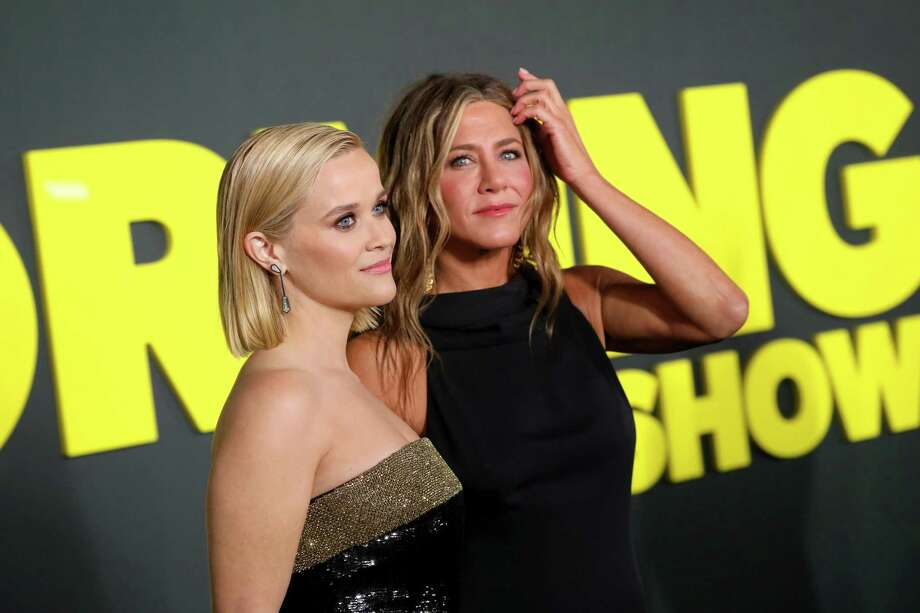 """Reese Witherspoon and Jennifer Aniston attend Apple's global premiere of """"The Morning Show"""" at Josie Robertson Plaza and David Geffen Hall, Lincoln Center for the Performing Arts in New York City. Photo: Brian Ach, Stringer / Getty Images For Apple TV+ / 2019 Getty Images"""