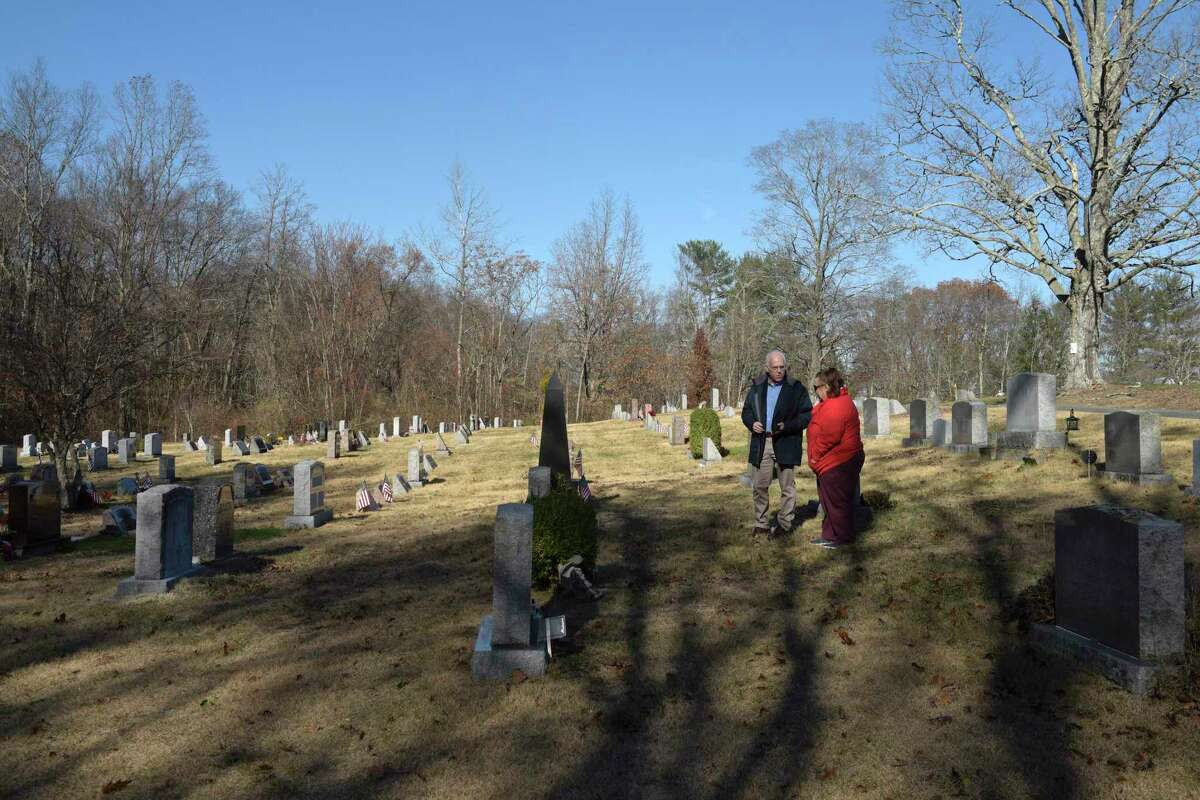 Jeff Nolan, with the Central Cemetery Association in Brookfield, talks with Mary Cipolla, who was visiting the cemetery. Nolan is advocating for cemeteries to be managed on a regional or state level. Thursday morning, November 21, 2019, in Brookfield, Conn.