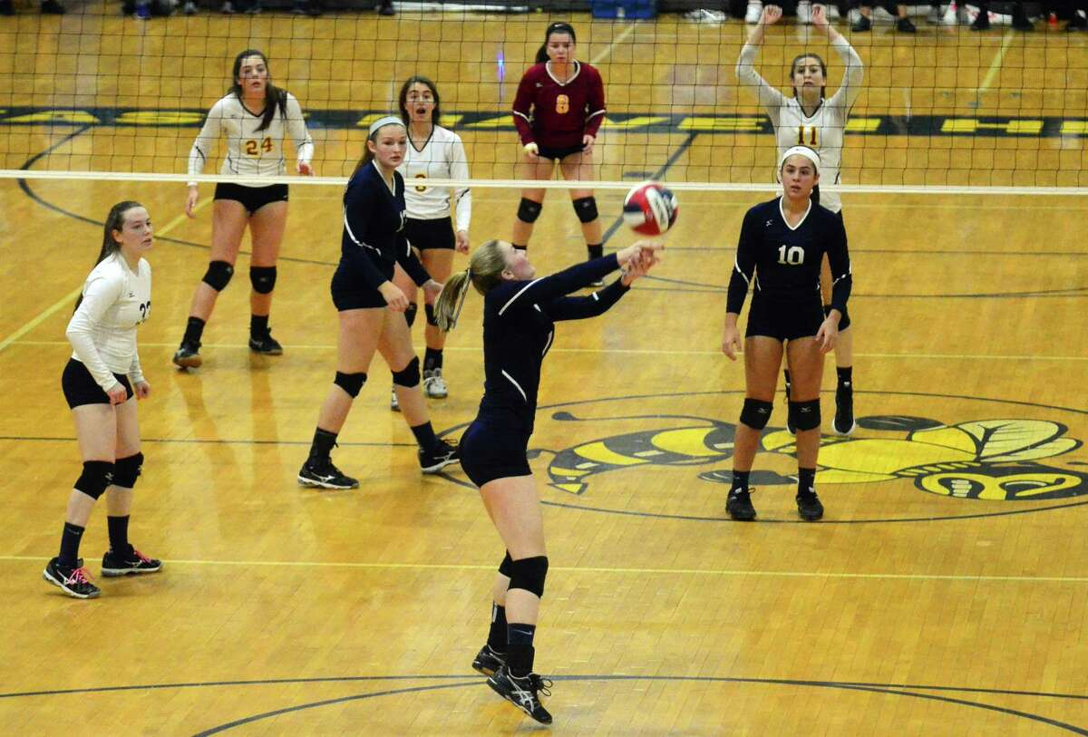 Class M volleyball championship action between St. Joseph and East Haven in East Haven in 2017.