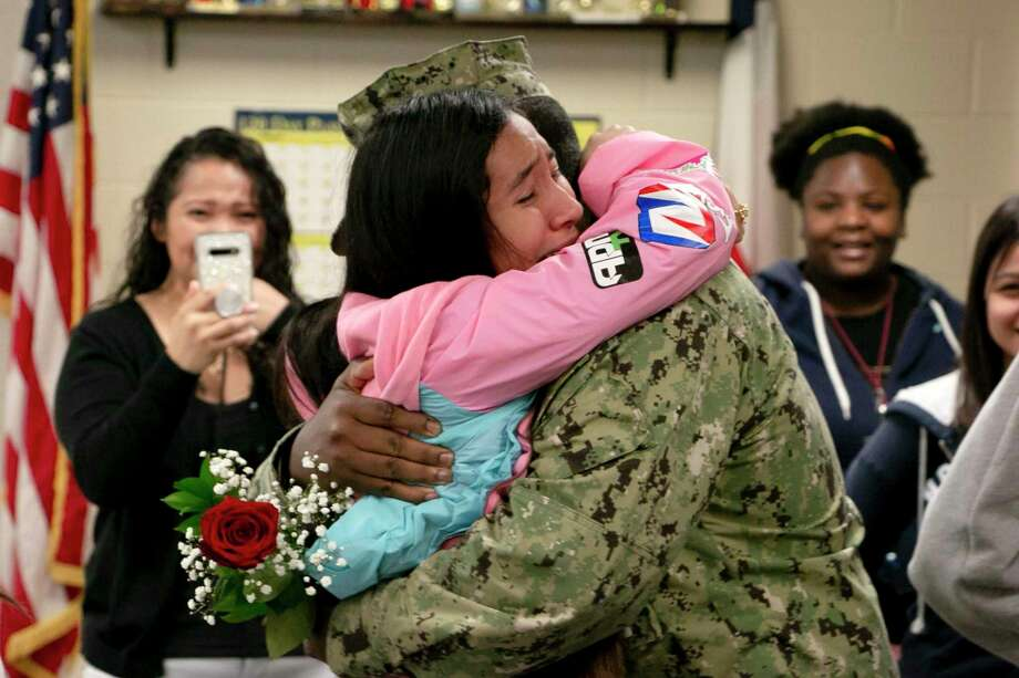 After serving 11 months deployed in Djibouti, a country in east Africa, U.S. Navy Chief Petty Officer Steven Williams surprised his 16-year-old daughter Lucy the morning of Nov. 22 in her ROTC class at Summer Creek High School. Photo: Savannah Mehrtens/Staff Photo / Savannah Mehrtens/Staff Photo
