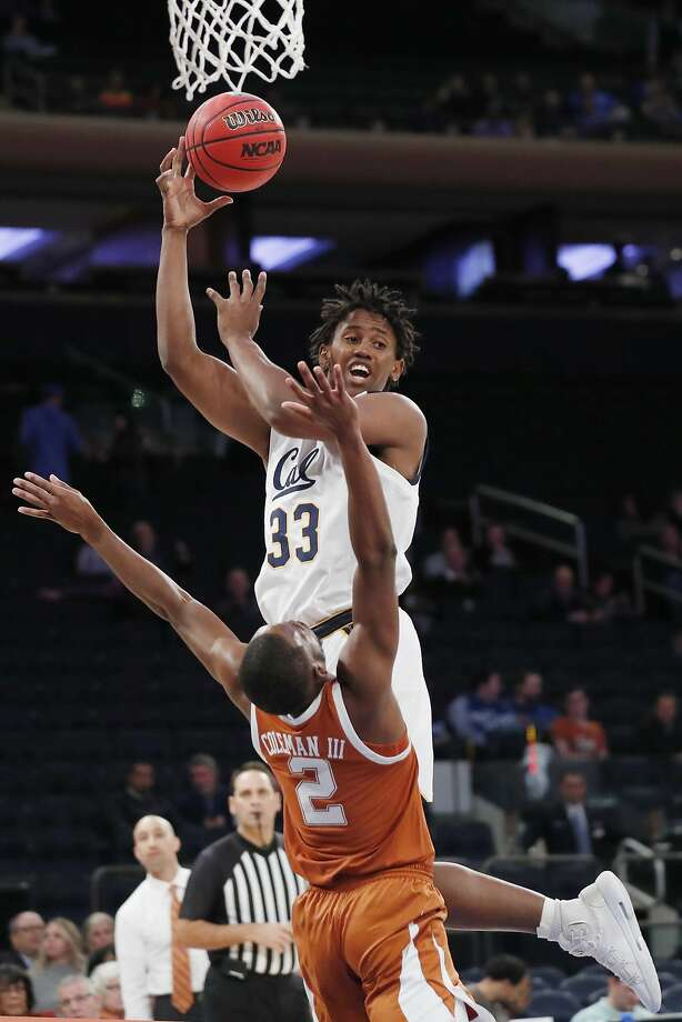 Cal forward D.J. Thorpe looks to pass as he collides with Texas guard Matt Coleman III at Madison Square Garden. Photo: Kathy Willens / Associated Press