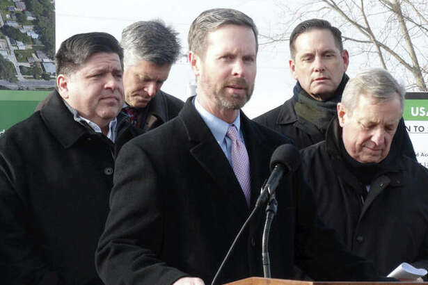 Republican U.S. Rep. Rodney Davis of Illinois speaks Friday at a groundbreaking ceremony for a construction project in Springfield with Gov. J.B. Pritzker, left, and Democratic U.S. Sen. Dick Durbin. LaHood later said he believes the impeachment process against President Trump has resulted in shutting down legislative progress on all other issues. (Capitol News Illinois photo by Peter Hancock)