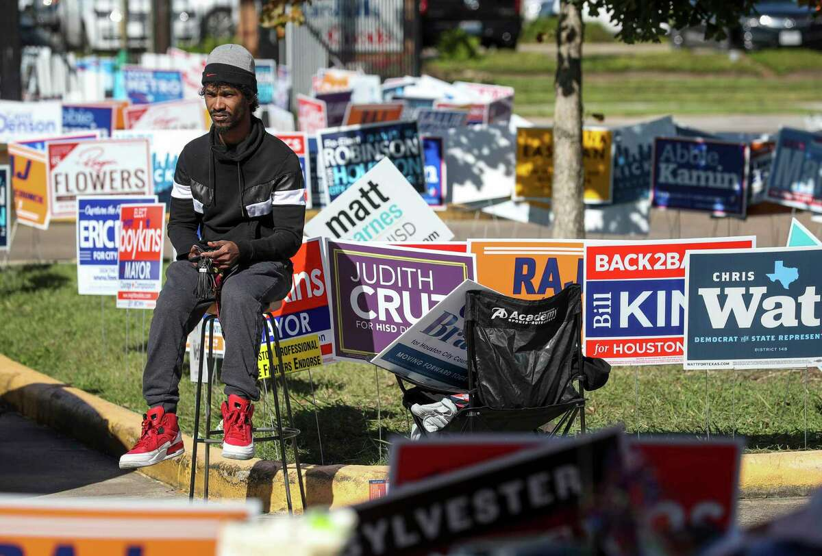 """George Wyche, a canvasser for Carla Brailey, waits for voters in the afternoon at the West Gray Metropolitan Multi-Service Center on Thursday, Oct. 31, 2019, in Houston. """"It's hard work, it's not easy out here,"""" he said."""