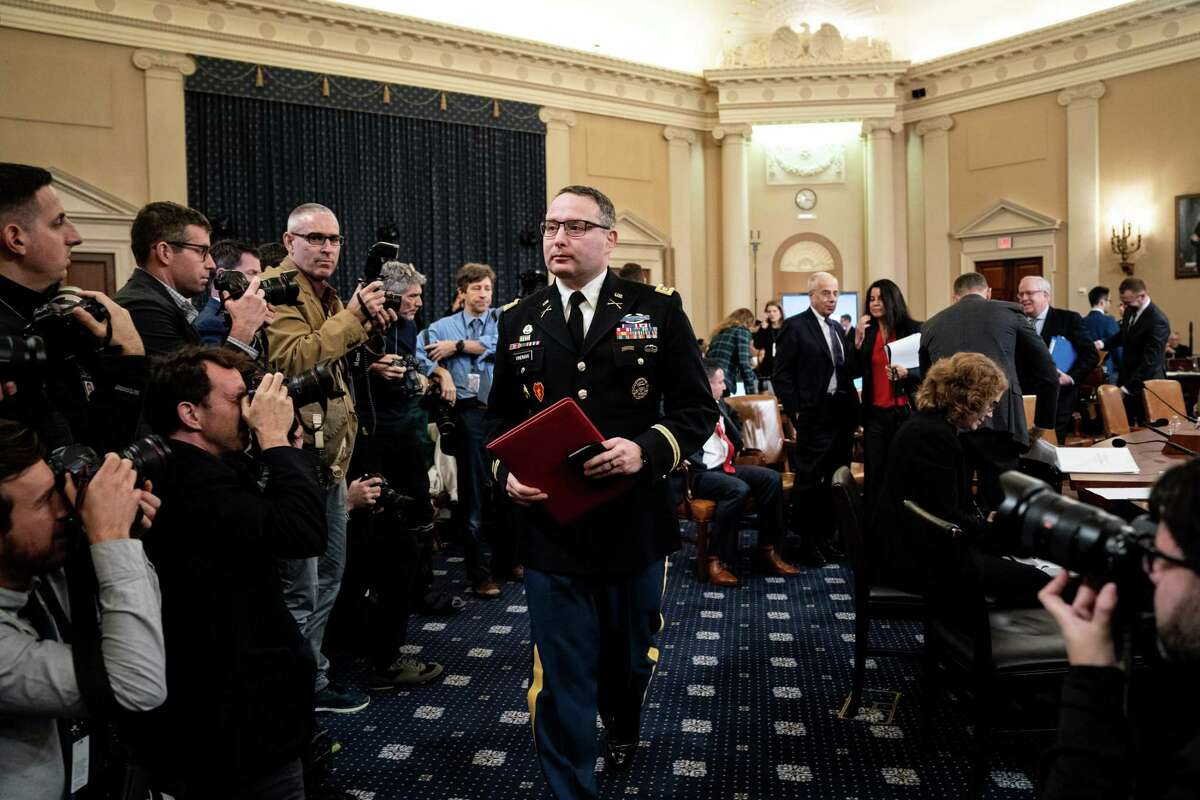 Lt. Col. Alexander Vindman, the top Ukraine expert at the National Security Council, takes a break while testifying during a House Intelligence Committee impeachment inquiry hearing in Washington, Nov. 19, 2019. In a political drama that turns on the telling detail, the details of dress matter too. (Erin Schaff/The New York Times)