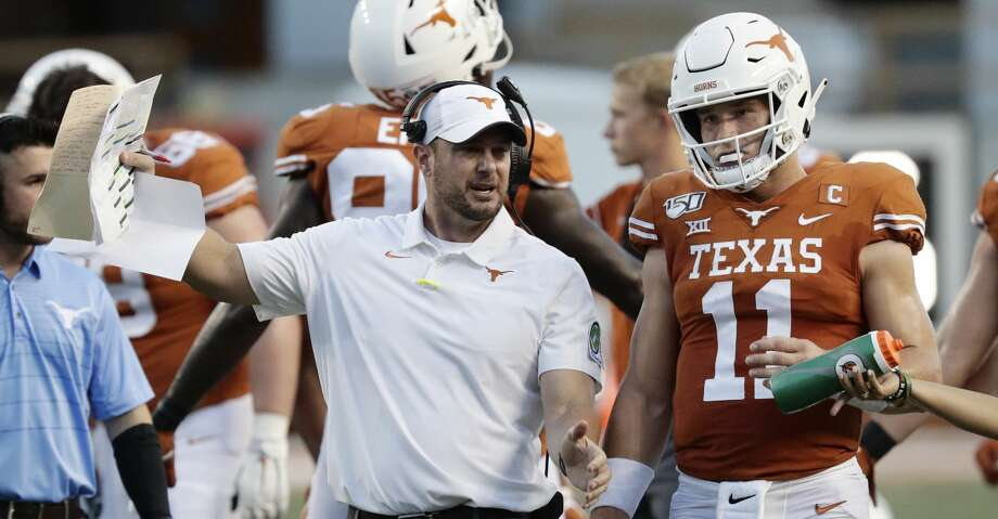 Texas head coach Tom Herman, left, and Texas quarterback Sam Ehlinger (11) during the first half of an NCAA college football game against Oklahoma State Saturday, Sept. 21, 2019, in Austin, Texas. (AP Photo/Eric Gay) Photo: Eric Gay/Associated Press