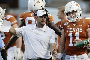 Texas head coach Tom Herman, left, and Texas quarterback Sam Ehlinger (11) during the first half of an NCAA college football game against Oklahoma State Saturday, Sept. 21, 2019, in Austin, Texas. (AP Photo/Eric Gay)