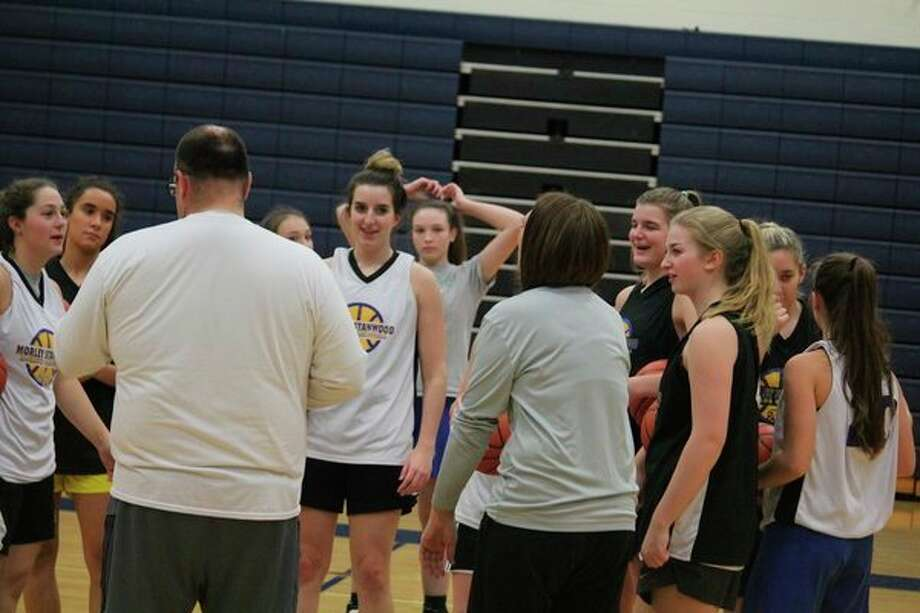 Morley Stanwood girls coach Rob Brauher (left) talks to his players after a Thursday practice. (Pioneer photo/John Raffel)