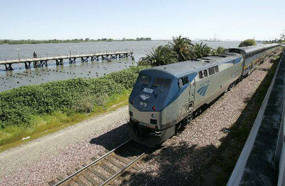 An Amtrak train pulls out of the Antioch station along the San Joaquin River.