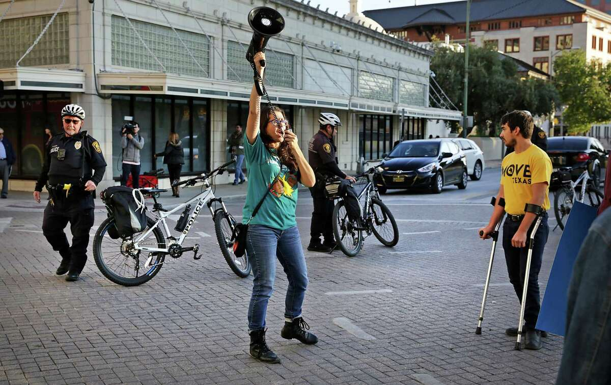 Joleen Garcia of the Texas Organizing Project leads a group of protesters demonstrating against Judge Peter Sakai's decision to prevent San Antonio's paid sick leave ordinance from taking effect Dec. 1. The group blocked traffic for awhile at Flores and Commerce on Friday, Nov. 22, 2019.