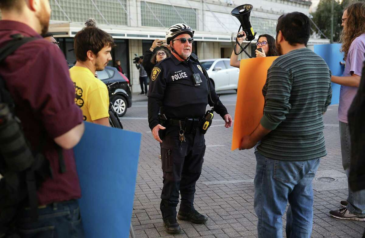 San Antonio Police officer Lujan tells protesters to leave the intersection of Flores and Commerce St. as they demonstrate against Judge Peter Sakai's decision to prevent the paid sick leave ordinance from taking effect Dec. 1.