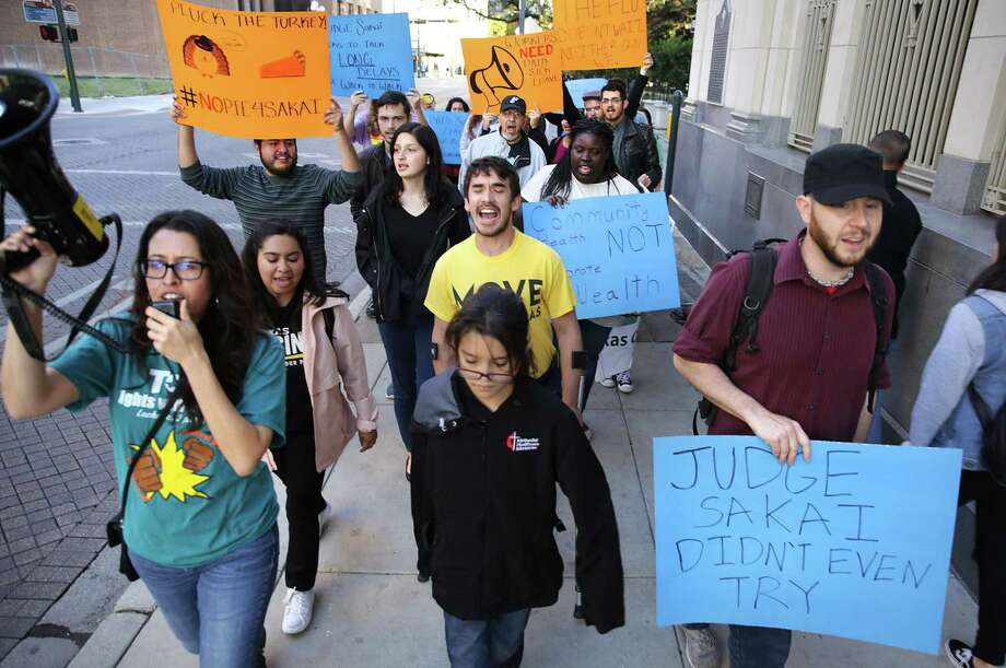 Protesters take to the streets in response to Judge Peter Sakai's decision to prevent the paid sick leave ordinance from taking effect. A reader says this will make no difference. Photo: Bob Owen /Staff Photographer / San Antonio Express-News