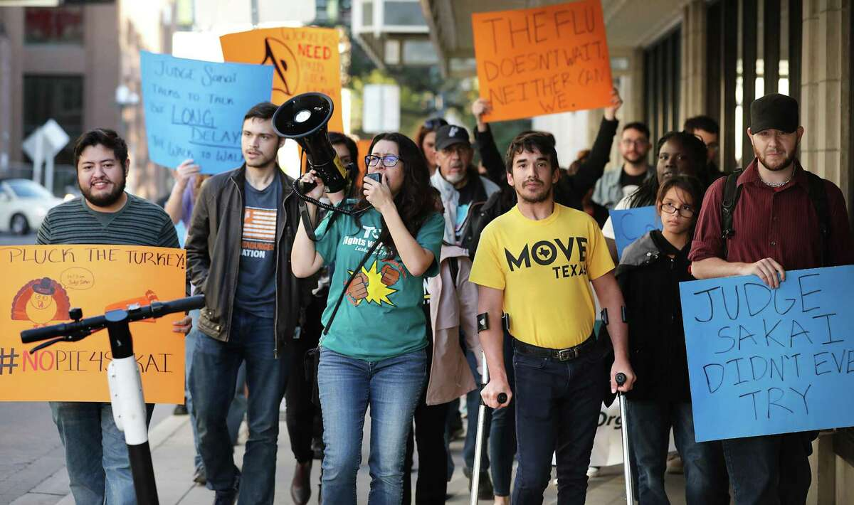 Joleen Garcia, left, of the Texas Organizing Project leads a march of protesters with Alex Birnel, right, with MOVE Texas, Nov. 22, 2019 in downtown San Antonio after Judge Peter Sakai's decision to prevent a paid sick leave ordinance from taking effect Dec. 1. Progressive activists have called on City Council to delay a vote on a $191 million stimulus package aimed at providing economic relief for residents and businesses hit hard by the coronavirus pandemic, saying the public hasn't had enough time to weigh in.