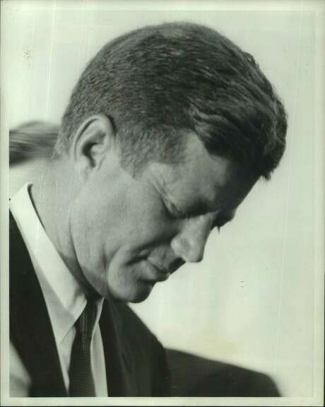 MOMENT OF SILENCE-President John F. Kennedy paused briefly after Mayor Lewis Cutrer presented him a Key to the City at arrival ceremonies Tuesday at Houston International Airport. Kennedy flew in for an overnight visit to inspect National Aeronautics and Space Administration operations here. JFK.
