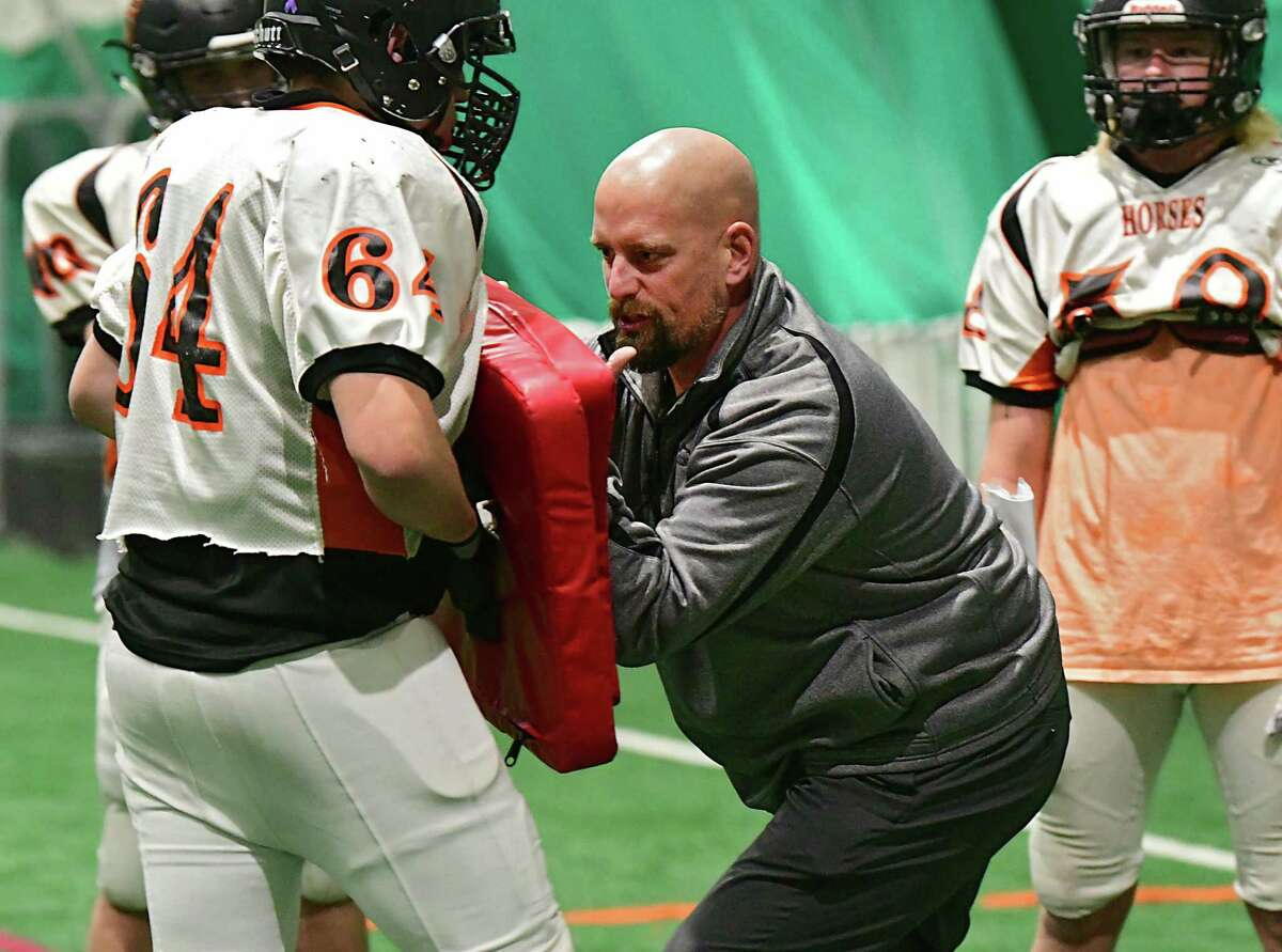 Schuylerville football coach John Bowen demonstrates a drill to his players during practice in the Adirondack Sports Complex on Wednesday, Nov. 20, 2019 in Queensbury, N.Y. (Lori Van Buren/Times Union)
