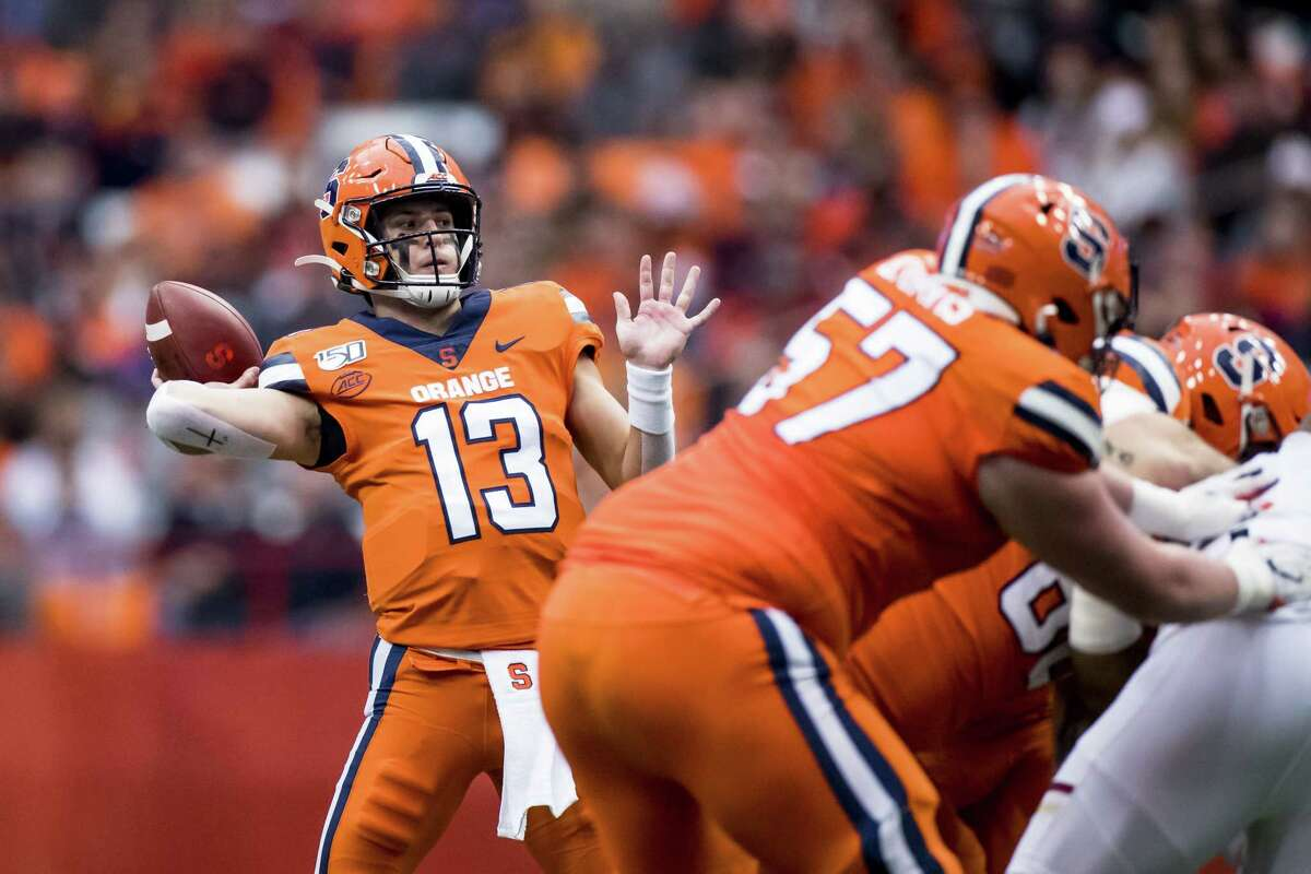 SYRACUSE, NY - NOVEMBER 02: Tommy DeVito #13 of the Syracuse Orange passes the ball for a touchdown to Trishton Jackson #86 (not pictured) during the first quarter against the Boston College Eagles at the Carrier Dome on November 2, 2019 in Syracuse, New York. (Photo by Brett Carlsen/Getty Images)