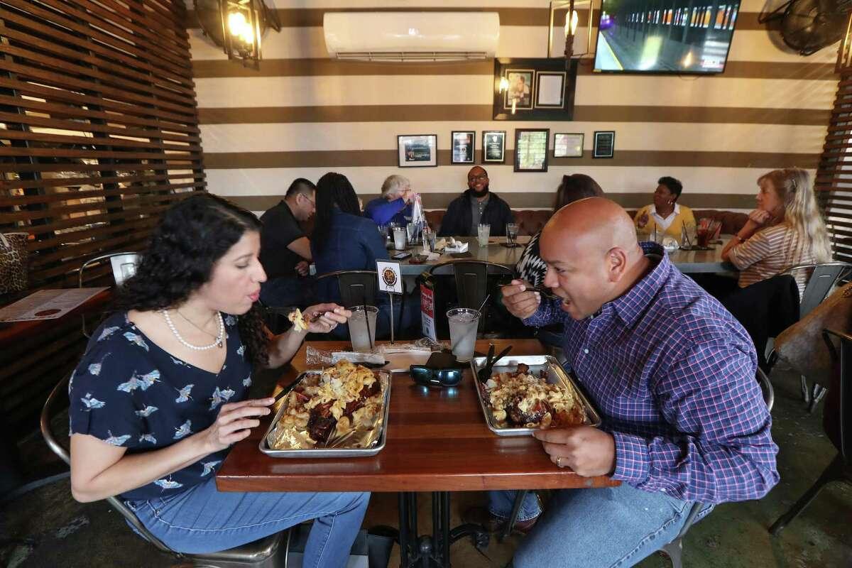 Leslie and Issa Kamara enjoy their lunch at the Turkey Hut Friday, Nov. 22, 2019, in Houston.