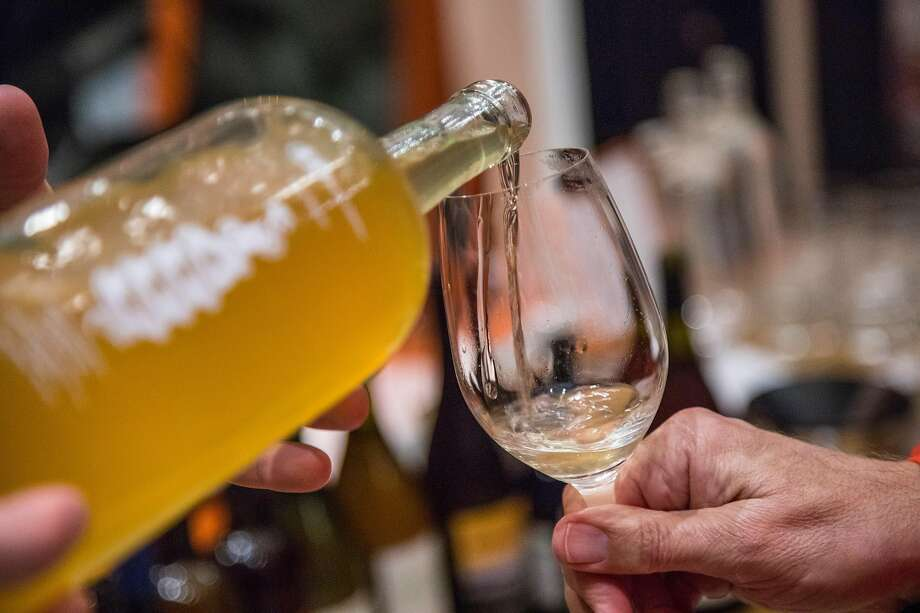 Tyler Kavanagh pours a funky sparkling wine at Biondivino. Photo: Brian Feulner / Special To The Chronicle