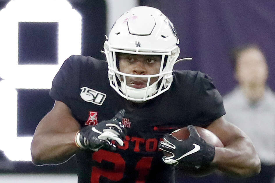 Houston Cougars running back Patrick Carr (21) runs the ball during the third quarter of the AdvoCare Texas Kickoff game at NRG Stadium, Friday, Sept. 13, 2019, in Houston.