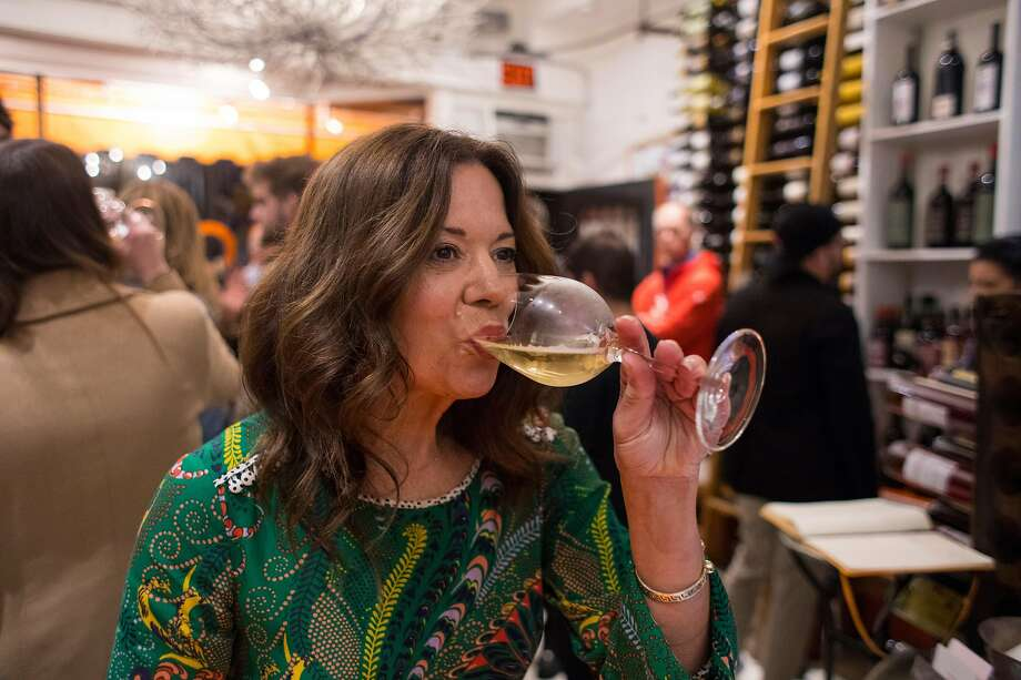 Biondivino owner Ceri Smith sips a glass of Ca' dei Zago, a bottle-fermented sparkling wine. Photo: Brian Feulner / Special To The Chronicle
