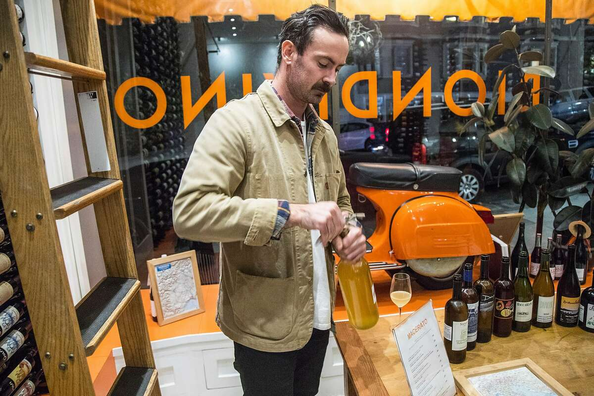 Tyler Kavanagh sets up a wine tasting at Biondivino, a wine shop on Russian Hill. Biondivino hosted a wine tasting on Tuesday, Nov. 19, 2019 in San Francisco, Calif.