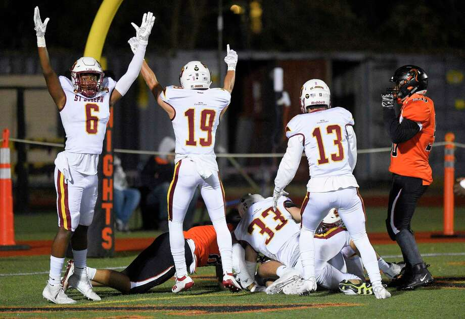 St. Joseph Noah Gage (6) and his teammates celebrate a fumble recovery by Owen DaSilva (86) in the Stamford endzone for a touchdown in the first quarter of a FCIAC football game against Stamford at Boyle Stadium on Nov. 22, 2019 in Stamford, Connecticut. St. Joseph won 58-0. Photo: Matthew Brown / Hearst Connecticut Media / Stamford Advocate