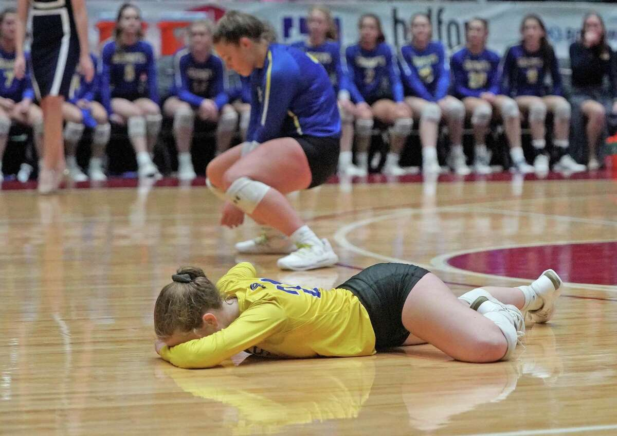 Alamo Heights' Ella Sanders, in yellow, reacts after missing an attempt at a diving save in the third game during the Alamo Heights High School vs. Canyon Randall High School state semifinal volleyball match on Friday, November 22, 2019 at the Curtis Culwell Center in Garland, Texas. Randall won the match 3 games to zero. CREDIT: Louis DeLuca for the San Antonio Express News