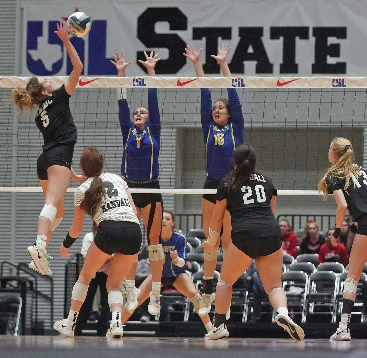 Alamo Heights' Avery Rosenblum (1) and Faith Holzhausen (16) try to block the shot of Randall's Zoe Parker (5) during the Alamo Heights High School vs. Canyon Randall High School state semifinal volleyball match on Friday, November 22, 2019 at the Curtis Culwell Center in Garland, Texas. Randall won the match 3 games to zero. CREDIT: Louis DeLuca for the San Antonio Express News