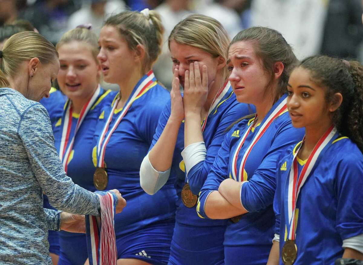 Clemens' teammates Rylee Thomas, Canada Buchanan, Kayla Teeler, Danielle Stephenson-Pino and Mia Bartholomew, left to right, line up sadly to receive their medals after the Schertz Clemens High School vs. Northwest Byron Nelson High School state semifinal volleyball match on Friday, November 22, 2019 at the Curtis Culwell Center in Garland, Texas. Nelson won 3 games to 0. CREDIT: Louis DeLuca for the San Antonio Express News