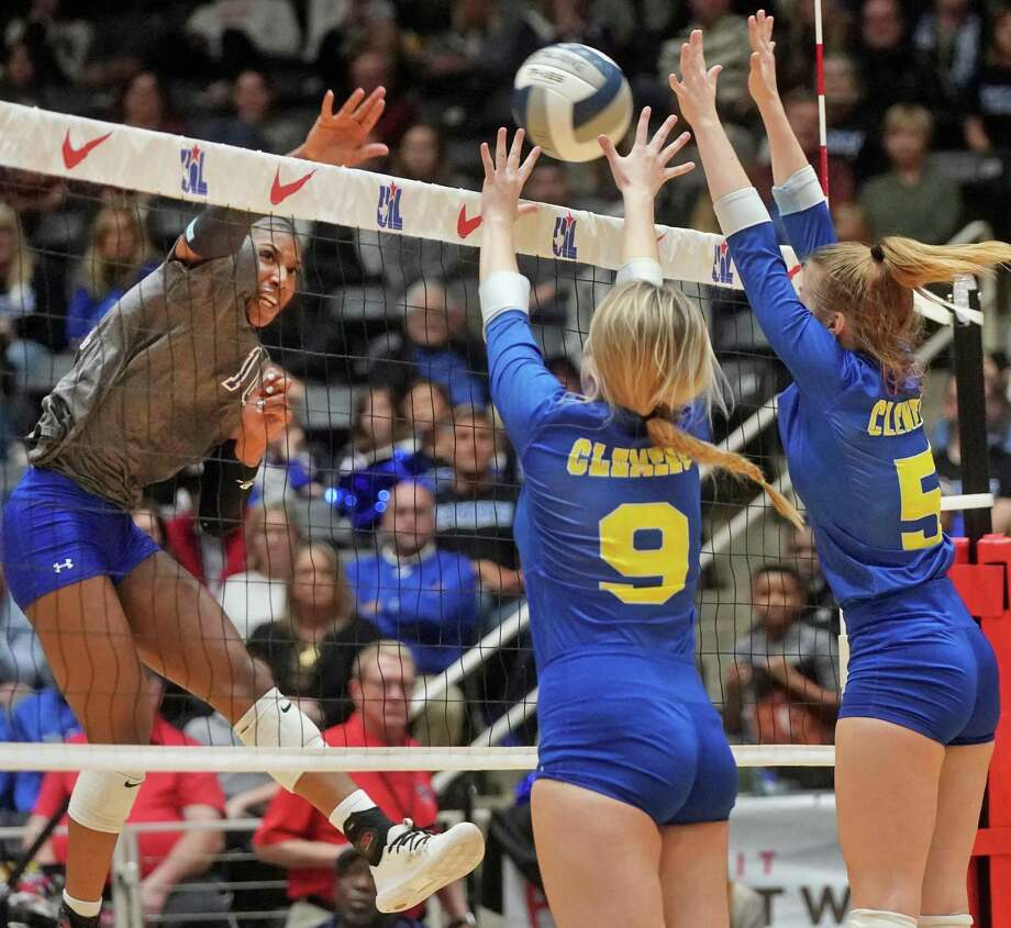 Northwest Nelson's Charitie Luper (10), shown here spiking the ball as Clemens' Kayla Teeler (9) and Cassidy Steadman (5) defend during Friday's state semifinal match, was named MVP after leading her team past Plano West in the state final on Saturday. Photo: Louis DeLuca / Copyright 2019 Louis DeLuca for the San Antonio Express News