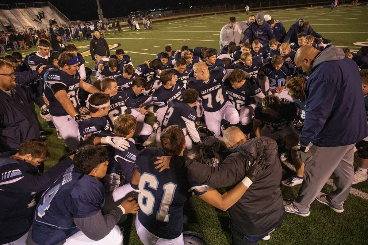 Greenwood football players and coaches pray after winning against Aubrey for the Class 4A Division II area playoff game Friday, Nov. 22, 2019 at Clyde Football Stadium. Jacy Lewis/Reporter-Telegram