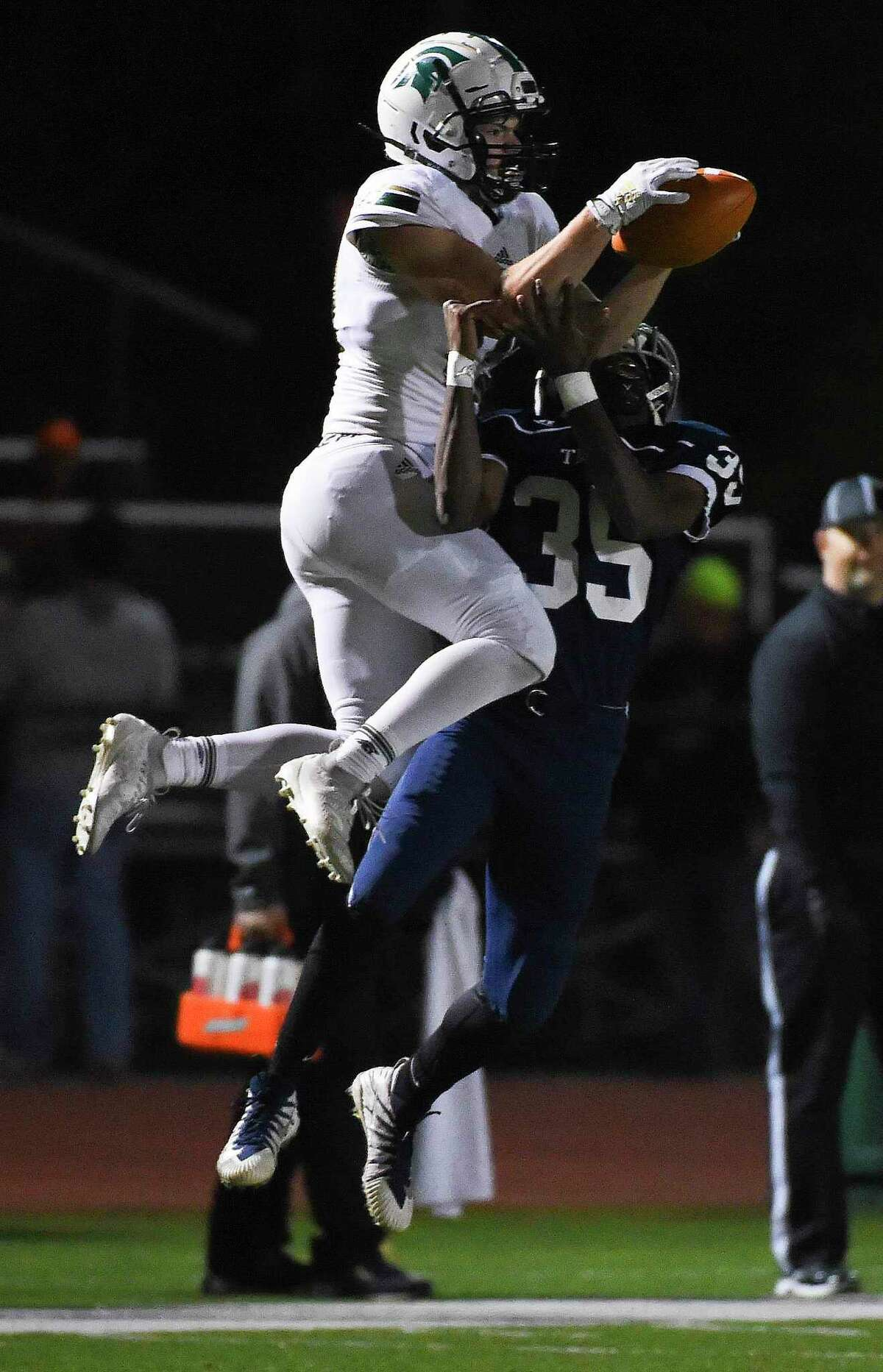 TWCA wide receiver Caleb Chappelle, left, catches a pass over TSD defensive back Broderick Johnson during the first half of a TAPPS Division III regional high school football playoff game, Friday, Nov. 22, 2019, in The Woodlands.